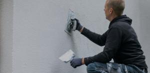 Restoration worker putting decorative plaster on house exterior - J&R Contracting - Toledo, OH, Northwest Ohio